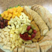 Cheese-tray,-with-assorted-crackers-and-Italian-bread